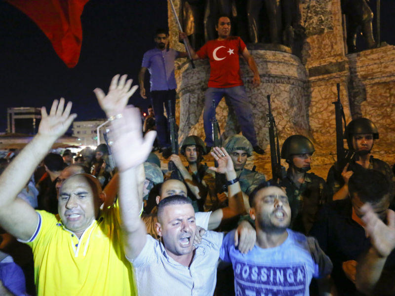 People demonstrate in front of the Republic Monument at the Taksim Square in Istanbul, Turkey, July 16, 2016.   REUTERS/Murad Sezer - RTSI7JD